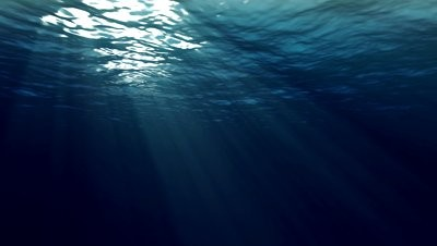 stock-footage-an-underwater-looped-scene-with-sun-rays-shining-through-the-water-s-glittering-and-moving-surface-400x226