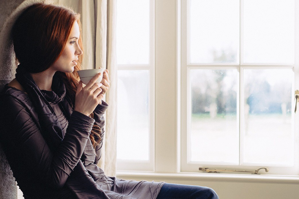 woman-looking-out-the-window-young